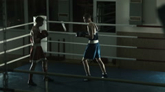 Silhouette training sparring of two boxers on a ring Stock Footage