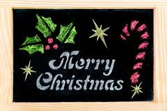 Wooden frame vintage chalkboard with Merry Christmas message and hand drawing Stock Photos