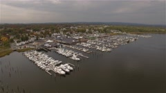 Aerial view of Staten Island. Camera hovering right over boats moored in Marina. - stock footage