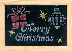 Wooden frame vintage chalkboard with Merry Christmas message, hand drawing sy Kuvituskuvat