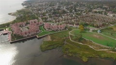 Aerial view of Staten Island houses. Camera moving to the land over water. - stock footage
