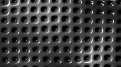 Carbon, metal plate with holes seamless loop motion background - stock footage