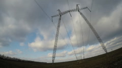 Electric high voltage pylon against sky. Stock Footage