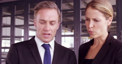 Surprised businesswoman talking to a businessman Stock Footage