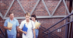 Doctors climbing the stairs together Stock Footage