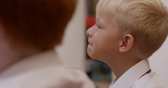 Stock Video Footage of Boy paying attention in classroom