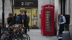 Red phone box and crowds in Soho, London Stock Footage