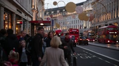 Regent street christmas shoppers and Red busses, London, England Stock Footage