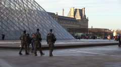 France, Paris, soldiers, military next to Louvre Stock Footage