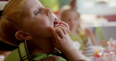 Boy making funny faces during a birthday party - stock footage