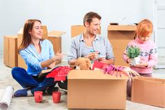 The happy family  at repair and relocation Stock Photos