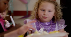Girl having birthday cake in classroom Stock Footage