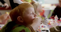 Boys making funny faces during a birthday party - stock footage