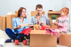 The happy family  at repair and relocation - stock photo