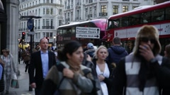 Regent Street crowds and red busses in London, England Stock Footage