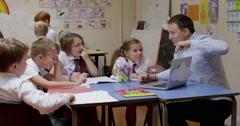 Teacher teaching students on laptop - stock footage