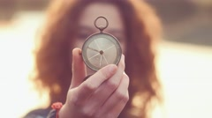 Teenager girl  holding an old compass in hand Stock Footage