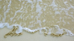 Sand written 2015 washed away by a wave Stock Footage
