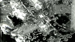 Carbonated limpid water with bubbles - stock footage