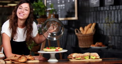 Smiling waitress showing strawberry pie Stock Footage