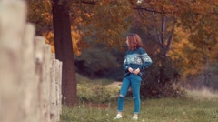 girl on fence looking away - stock footage