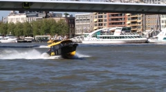 Water taxi boat pass by the Maas river in Rotterdam, Netherlands. Stock Footage