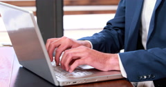 Serious businessman typing on laptop Stock Footage
