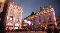 Piccadilly Circus best wide shot: red bus passing, London, Englad Stock Footage