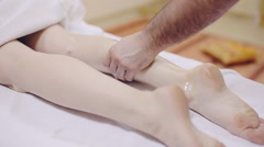 Massage therapist making massage of leg. Spa Stock Footage