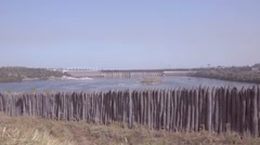 View of the hydroelectric power plant due to the stockade Zaporozhye Se - stock footage