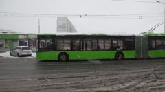 Stock Video Footage of Two trolleybus go forward in the snowy city Kharkov Ukraine in December