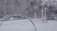 View of the playground and the road in heavy snow - stock footage
