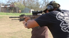 Side Shot of Man Shooting AR-15 Assault Rifle at Outdoor Target - stock footage