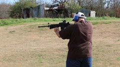 Man Shooting AR-15 Assault Rifle at Outdoor Target Stock Footage