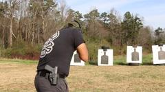 Rear Shot of Man Shooting AR-15 Assault Rifle at Outdoor Target - stock footage