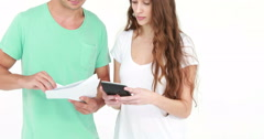 Stock Video Footage of Worried young couple with bills and calculator