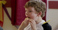 Boy having snacks during a birthday party Stock Footage