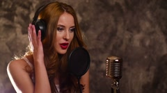 Woman recording a song in music studio,slow motion, close up Stock Footage