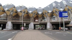 Cars pass below the famous cube houses in Rotterdam, Netherlands. Stock Footage