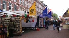 People walk by the Flea market in Amsterdam, Netherlands. Stock Footage