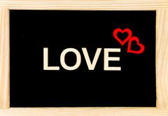 Wooden frame vintage chalkboard isolated on white with word LOVE  Stock Photos