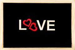 Wooden frame vintage chalkboard with Word LOVE created of wood letters - stock photo