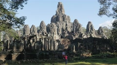 Stock Video Footage of Two woman making picture at Bayon in Angkor Thom,Siem Reap,Cambodia