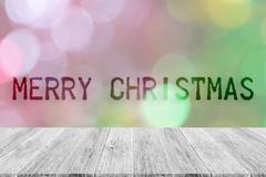 Wood terrace and Abstract bokeh background of Christmas tree - stock photo