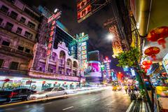 Neon lights and traffic on Yaowarat Road at night, in Chinatown, Bangkok, Tha Stock Photos