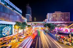 Long exposure of traffic and modern buildings on Ratchadamri Road at night, a Stock Photos