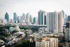 Hazy view of skyscrapers in Bangkok, Thailand. - stock photo