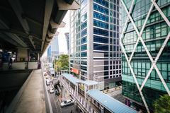 Elevated walkways and modern buildings at Surasak, in Bangkok, Thailand. - stock photo