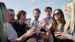 Stock Video Footage of Young couple toasting wine glasses while partying on terrace