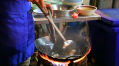 chef and street food cooking in Yaowarat street bangkok destination to visiting - stock footage